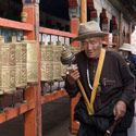 Pilgrims turning prayer wheels, Ramoche Temple, Lhasa, Tibet.