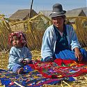 Uros woman & child, Floating Islands, Lake Titicaca, Peru.