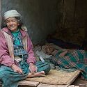 Nepalese woman with sick relative, Nepal.