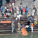Body being purified in the Bagmati River before cremation, Nepal.
